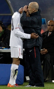 Team USA Coach Bob Bradley consoles Ricardo Clark at the 2010 World Cup match with Ghana
